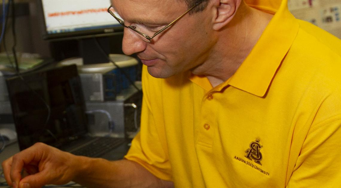 Martin Reisslein, an Arizona State University electrical and systems engineering professor, is researching 5G technology that will be a major component of the next industrial revolution.  Photo by Jessica Hochreiter/ASU.