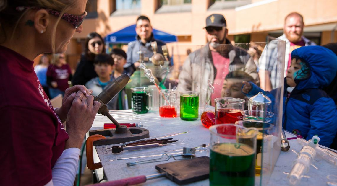 Glassblowing facility manager Christine Roeger demonstrates how glass can be molded with heat and cooling at the Tempe campus on Feb. 24, 2018, for ASU Open Door. Photo by Summer Sorg/ASU Now